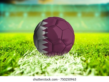 3D rendering football ball with the national flag of Qatar ball with Green grass background