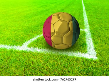 3D rendering football ball with the national flag of Guinea ball with Green grass background
