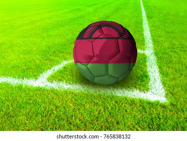 3D rendering football ball with the national flag of Malawi ball with Green grass background