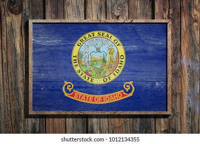 3d rendering of a Idaho State USA flag on a wooden frame and a wood wall