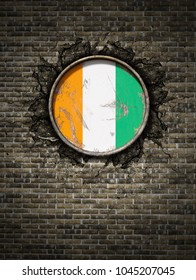 3d rendering of an Ivory Coast flag over a rusty metallic plate embedded on an old brick wall