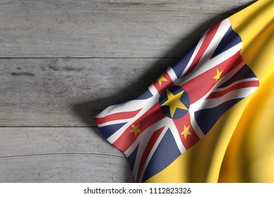 3d rendering of Niue flag over a wooden surface