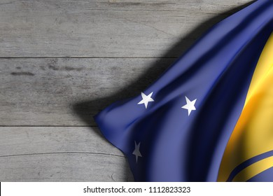 3d rendering of Tokelau flag over a wooden surface