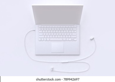 3d rendering white scene abstract laptop and earphone-headphone technology concept