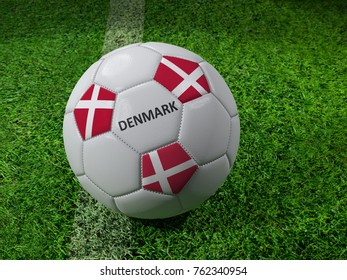 3D rendering of white soccer ball with imprinted Denmark as flag colors placed next to the pitch line