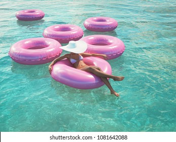 3d rendering. woman swimming on float in a pool.