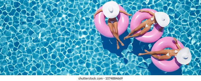 3d rendering. women swimming on float in a pool.