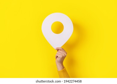 3d white pin in hand over yellow background
