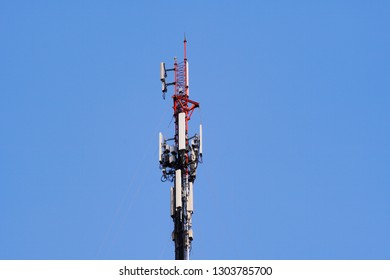 3G, 4G and 5G cellular. Base Station or Base Transceiver Station. Telecommunication tower. Wireless Communication Antenna Transmitter. Telecommunication tower with antennas and blue sky background.