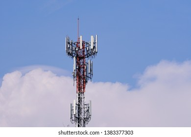 3G, 4G and 5G cellular. Base Station or Base Transceiver Station. Wireless Communication Antenna Transmitter. Telecommunication tower with antennas against blue sky and white clouds background.