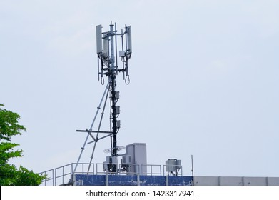 3G, 4G and 5G cellular. Base Station or Base Transceiver Station. Telecommunication tower. Wireless Communication Antenna Transmitter. Telecommunication tower with antennas on blue rooftop.