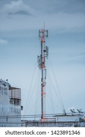 3G, 4G and 5G cellular. Base Station or Base Transceiver Station. Telecommunication tower. Wireless Communication Antenna Transmitter. Telecommunication tower with antennas on rooftop.