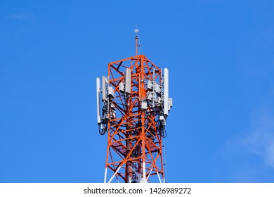 3G, 4G and 5G cellular. Base Station or Base Transceiver Station. Telecommunication tower. Wireless Communication Antenna Transmitter. Telecommunication tower with antennas  against blue sky.