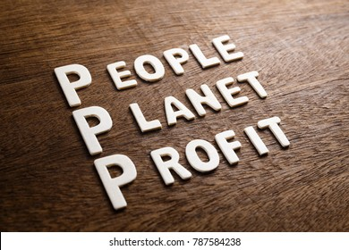 3P marketing (People Planet Profit) concept by wood letters on wood background