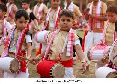 3rd April 2018, Guwahati, Assam, India. Children with traditional Bihu instrument Dhol during a folk dance workshop in Guwahati.