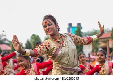 3rd April 2018, Guwahati, Assam, India. A dancer dancing Assamese traditional Bihu with child dancers during a folk dance workshop in Guwahati.