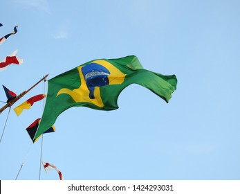 3rd of August 2015 - Close up of the Brazilian flag against a blue sky, Aalborg, Denmark