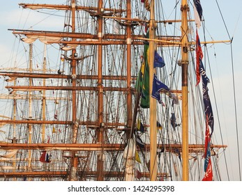 3rd of August 2015 - Details from a row of vintage tallships with masts, riggings and flags creating an artistic pattern, Aalborg, Denmark