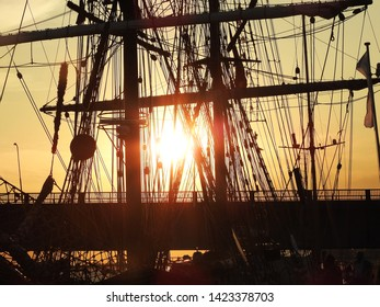 3rd of August 2015 - Details from a silhouette bridge and a silhouette vintage tallship with mast and rigging shot in backlight making an artistic impression, Aalborg, Denmark