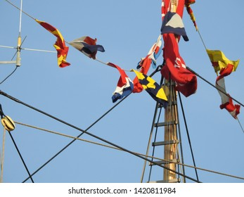3rd of August  2015 - Details from th mast an rigging of an old tallship with colorful signal flags against a blue sky creating an arty composition , Aalborg, Denmark