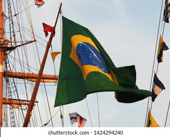 3rd of August 2015 - Details from a vintage tallship with the Brazilian flag in front of mast and rigging, Aalborg, Denmark