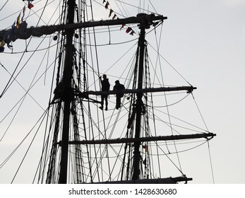 3rd of August 2015  - Details from a vintage tallship with view to silhouettes of young people hanging out in the rigging, Aalborg, Denmark
