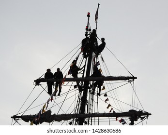 3rd of August 2015  - Details from a vintage tallship with view silhouettes of young people hanging out in the rigging, Aalborg, Denmark