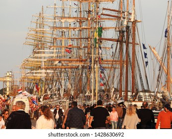 3rd of August 2015  - Scene from  Danish harbor with a crowd of people in front of vintage tallships, Aalborg, Denmark
