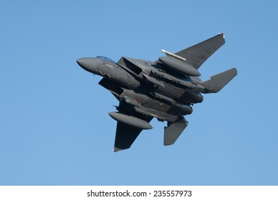 3rd December 2014. Wales, United Kingdom. McDonnell Douglas F-15 Eagle training, practicing  low flying techniques. A view of the underside, undercarriage against a clear blue sky