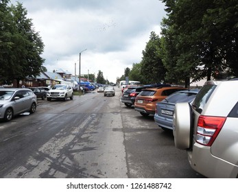 3rd of July 2018 - Scene from a russian street with a row of parked cars, Kingisepp, Russia