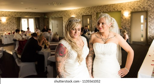 3rd - July - 2018 - Staffordshire, Beautiful gay, lesbian couple posing for pictures at the reception and generally having fun