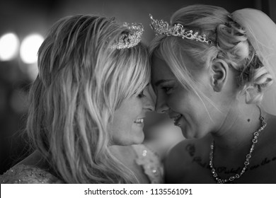 3rd - July - 2018 - Staffordshire, Beautiful gay, lesbian couple smiling at each other during their first dance
