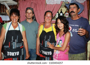 3rd of November 2013 - Scene from a Cuban countryside restaurant with the host family posing for a photo, Vinales, Cuba