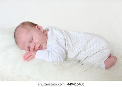 3-weeks newborn girl sleeps