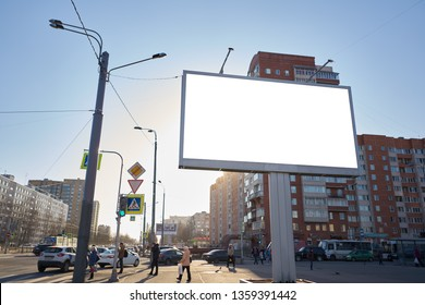 3x6 big billboard standing in the city against the sky during the daytime, with a white advertising space mockup