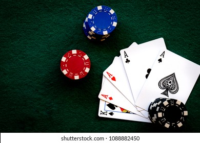 4 ACEs with different colored poker chips casino