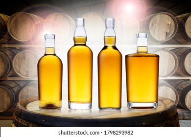 4 bottles of glowing amber whisky, in various shapes, set on top of an old barrel, in a barrel warehouse, back lit with colourful lens flare.