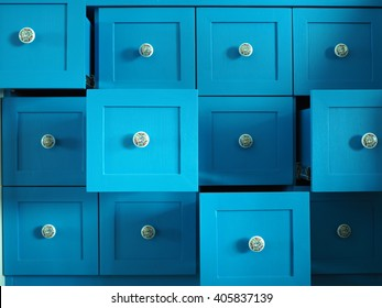 4 by 3 wooden modern blue drawers opening for storage