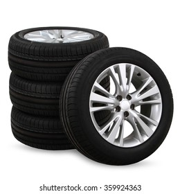 4 car tires on a white background