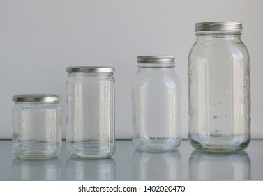 4 clear jars with metal lids in 500 ml and 1000 ml volumes