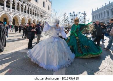 4 February 2018 - Venice, Italy: Venice Carnival (Italian: Carnevale di Venezia) 2018. Traditional Venetian mask in Piazza San Marco during the Volo dell' Angelo event.