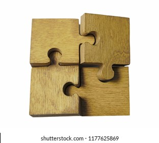 4 Four brown pieces of puzzle stand on wooden table isolated on  white background. empty copy space for inscription or objects. idea, sign,symbol, concept of connecting in family.business team