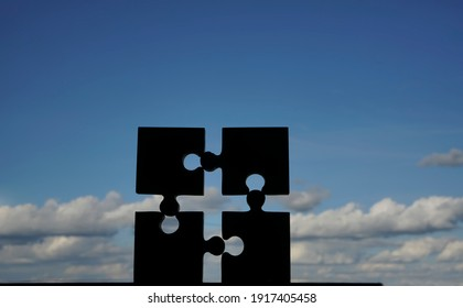 4 four  puzzle piece on blue cloudy sky  background. Jigsaw . 4 parts of whole. symbol of association and connection. business strategy.