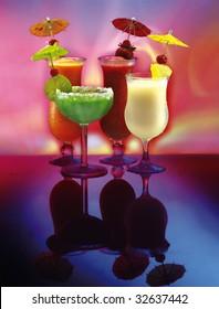 4 happy drinks, frozen Margarita, Pi���±a Colada, Strawberry and Mango daiquiris