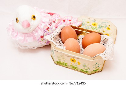 4 hard-boiled eggs in a vintage elegant box decorated with flowers.