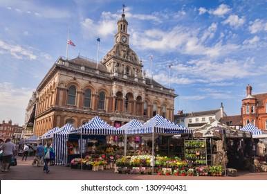 4 July 2015:  Ipswich, Suffolk, England, UK - People shopping at Ipswich Corn Exchange and market.
