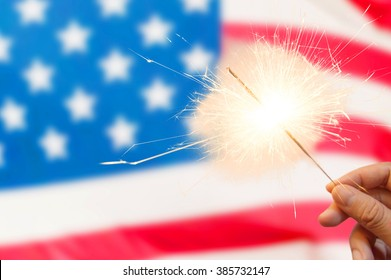 4 of july concept with sparkler and usa flag