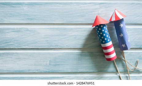 4  July, Independence day background with rockets over light blue background