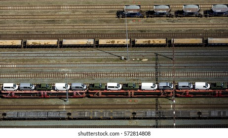 4 June 2015, Amersfoort, Netherlands. Aerial view of marshalling railway station with freight train with new cars.
