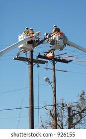 4 Linemen 2 buckets, replacing conduit on 12 kV circuit